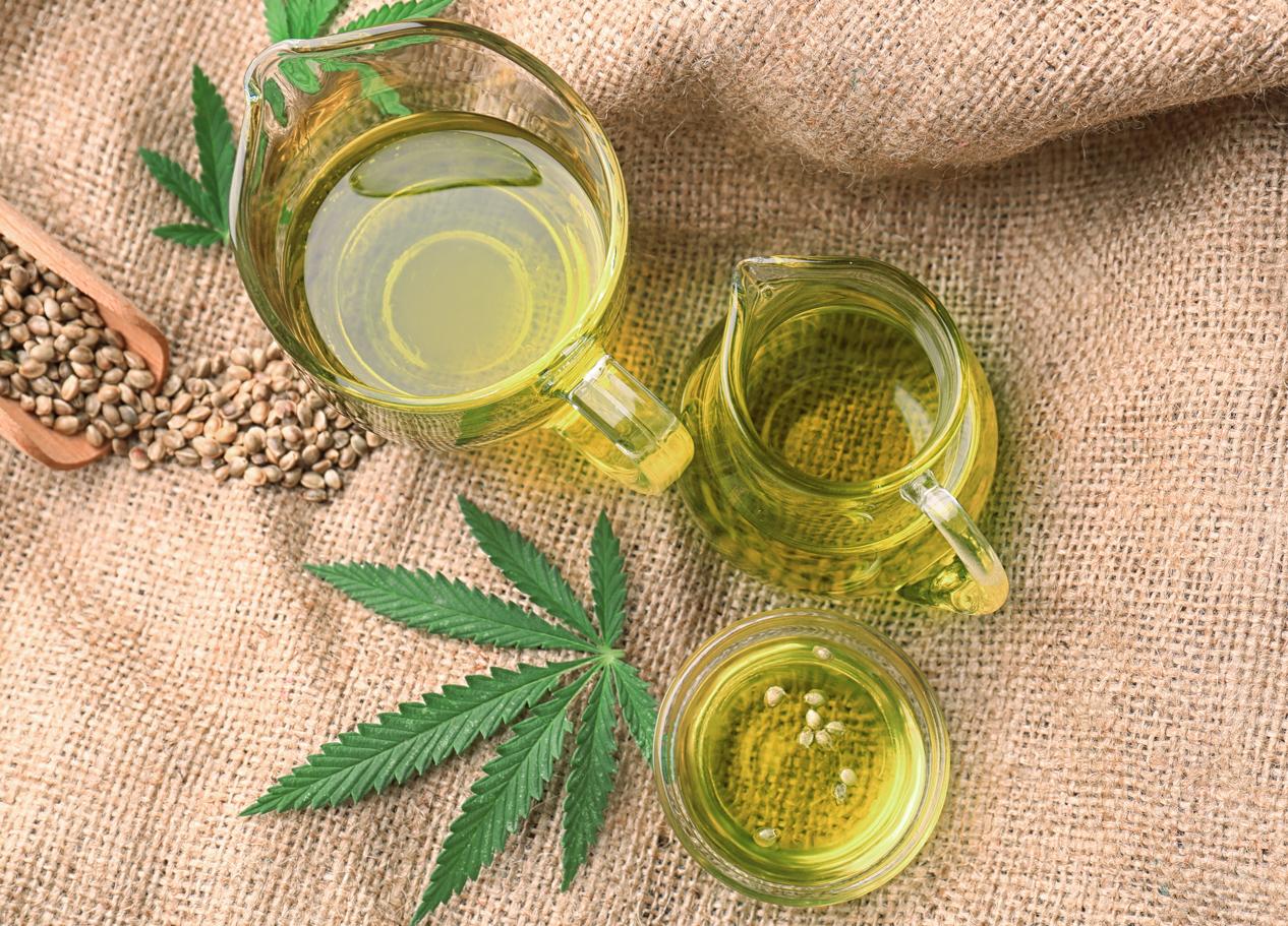 CBD Oils with hemp leaves on hemp fabric